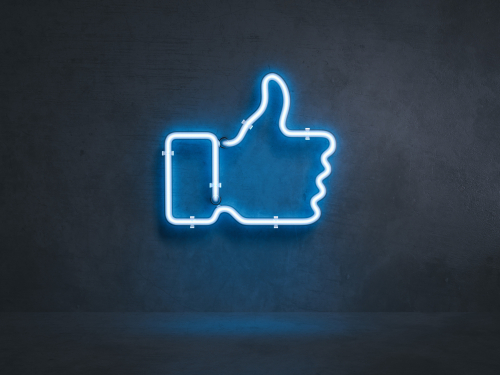 light blue electrical thumb up symbol on black wall, 3d rendering-img-blog