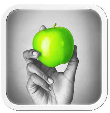 Color splash app demonstration. Bright green apple on black and white background